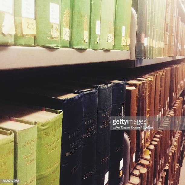 close-up of stack of books in shelf - book of ester stock pictures, royalty-free photos & images
