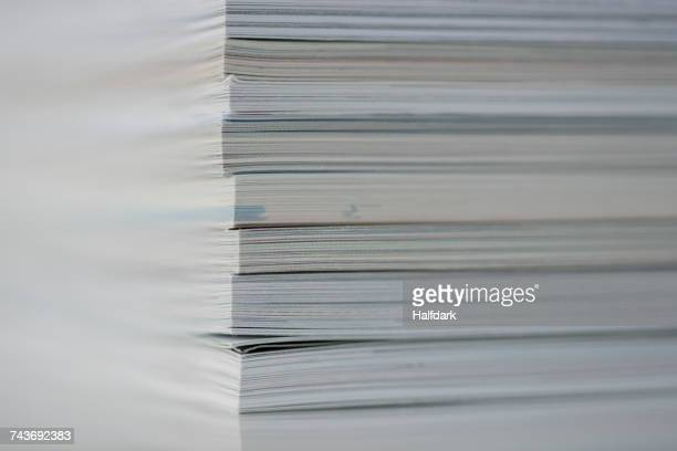 close-up of stack of books on table - magazine page stock photos and pictures