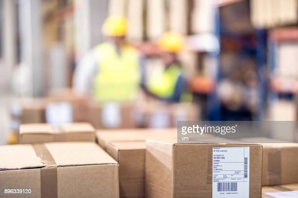 Close-up of stack of boxes in a warehouse