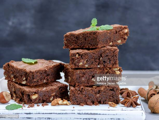 close-up of stack of brownies - brownie stock pictures, royalty-free photos & images