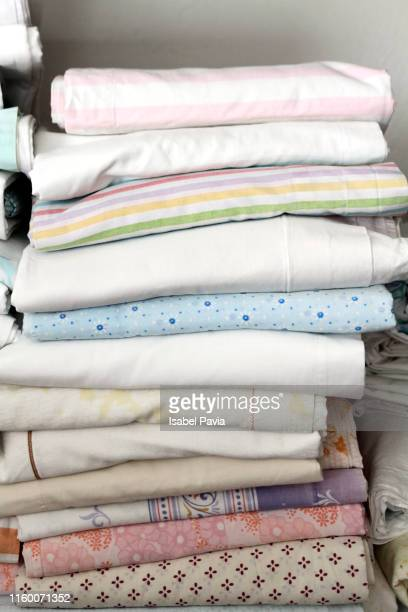 Close-Up Of Stacked Bed Sheets In Closet