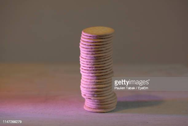 close-up of stacked biscuits on table - paulien tabak stock pictures, royalty-free photos & images