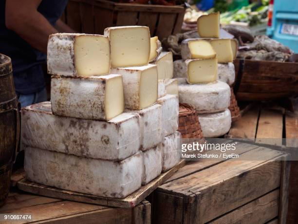 close-up of stacked cheese at table - marek stefunko - fotografias e filmes do acervo