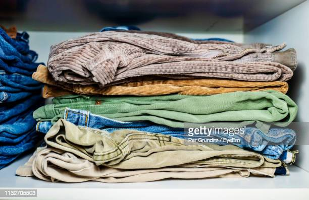 Close-Up Of Stacked Clothes In Cabinet