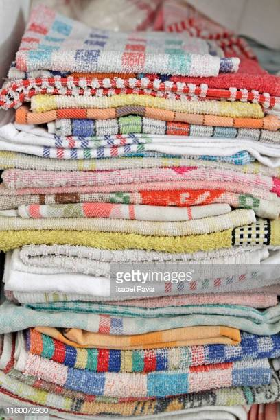 Close-Up Of Stacked Dish Towels In Closet