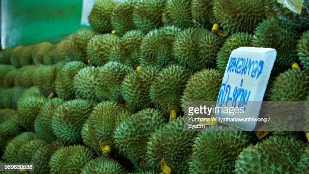 Close-Up Of Stacked Durians For Sale At Market