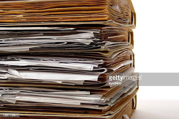 Close-up of stacked file folders on white background