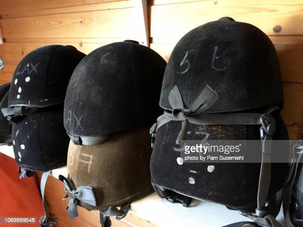 close-up of stacked horseback riding helmets - recreational horseback riding stock pictures, royalty-free photos & images