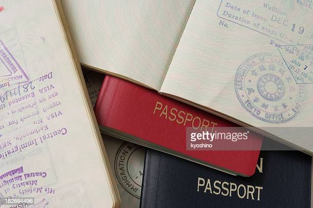 Close-up of stacked passports and stamp page