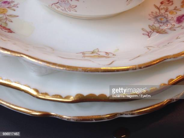 Close-Up Of Stacked Plates On Table