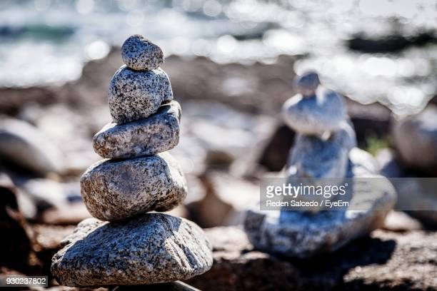 Close-Up Of Stacked Stones At Beach