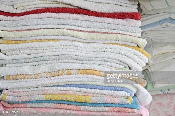 Close-Up Of Stacked Towels In Closet