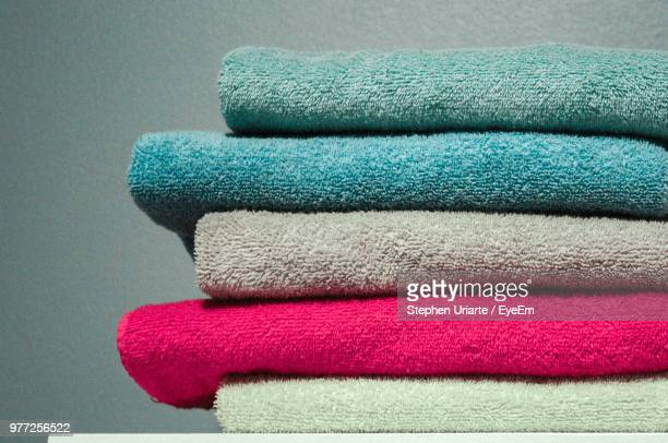 close-up of stacked towels on table - towel stock pictures, royalty-free photos & images