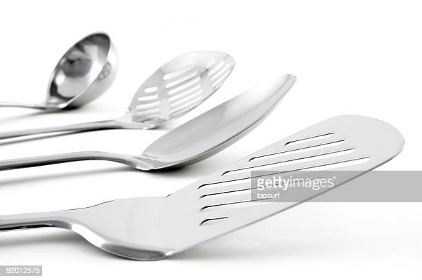 close-up of stainless kitchen utensils - cooking utensil stock photos and pictures