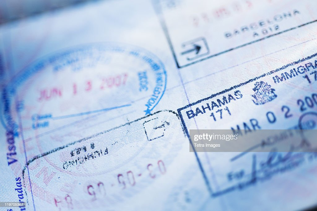 Close-up of stamps in passport : Stock Photo
