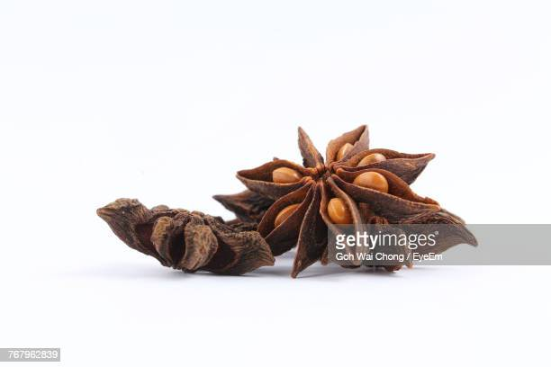 Close-Up Of Star Anise Against White Background