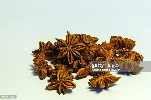 Close-Up Of Star Anises On White Background