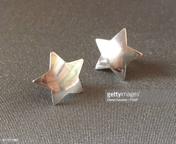 Close-up of star earrings