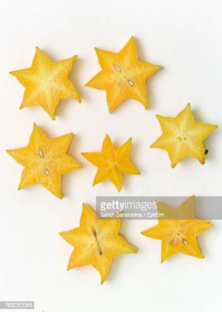 Close-Up Of Star Fruit Slices Against White Background