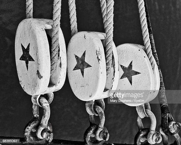 Close-Up Of Star Shape On Ship Pulleys