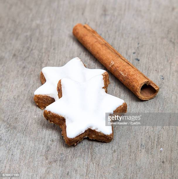 Close-Up Of Star-Shaped Cinnamon Cookies On Wooden Table