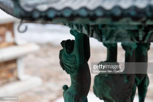 close-up of statue against metal - gwangju stock pictures, royalty-free photos & images