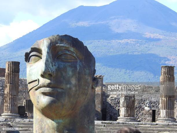 close-up of statue and columns at old ruin - pompeii stock photos and pictures
