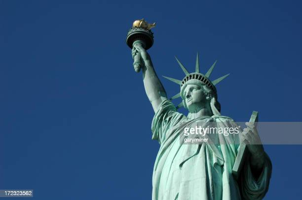 Close-up of Statue of Liberty against bright blue sky