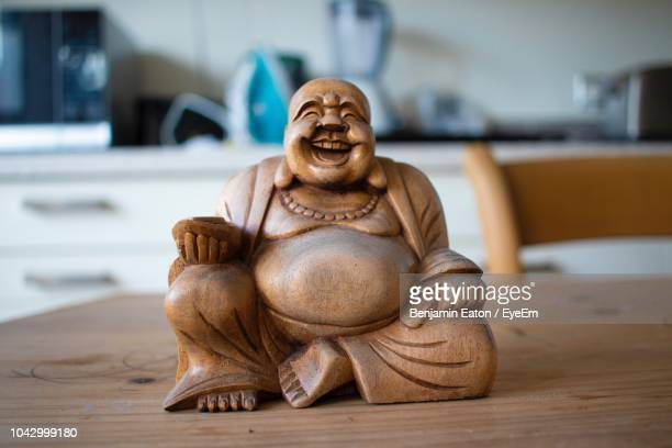 Close-Up Of Statue On Wooden Table