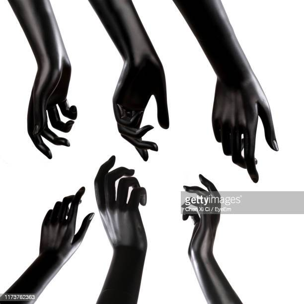 close-up of statues against white background - black square stock pictures, royalty-free photos & images