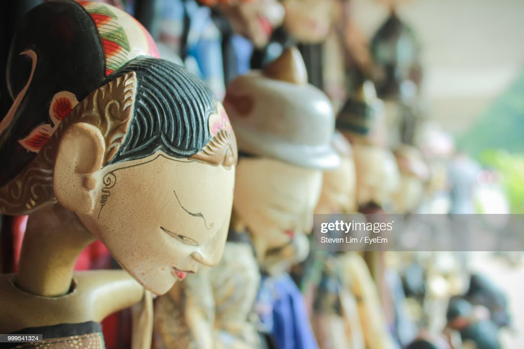 Close-Up Of Statues For Sale In Market : Stock Photo