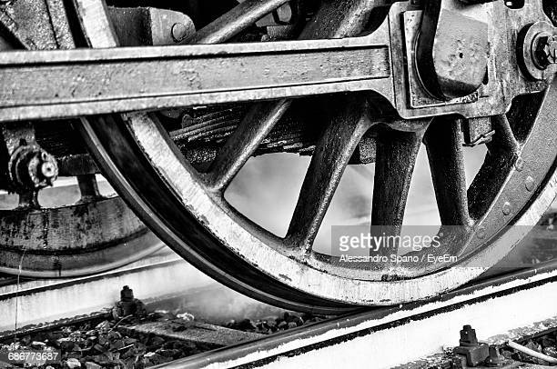 close-up of steam train wheel on railroad track - locomotive stock photos and pictures