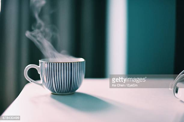 close-up of steaming coffee cup on table - steam stock pictures, royalty-free photos & images