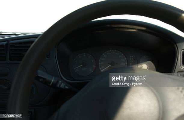 Close-Up Of Steering Wheel In Car
