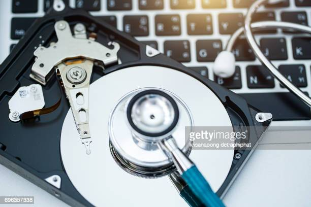 Close-up of stethoscope on laptop and Hard Disk