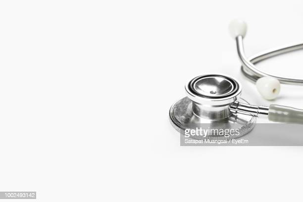 close-up of stethoscope on white background - stethoscope stock pictures, royalty-free photos & images