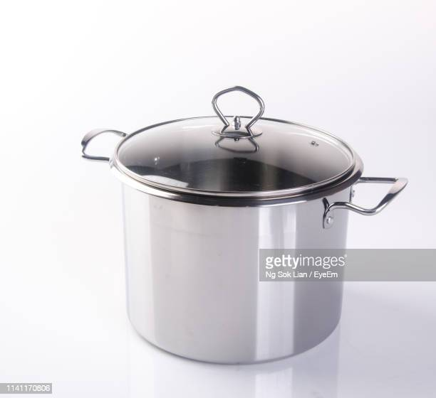 close-up of stew pot against white background - 調理鍋 ストックフォトと画像