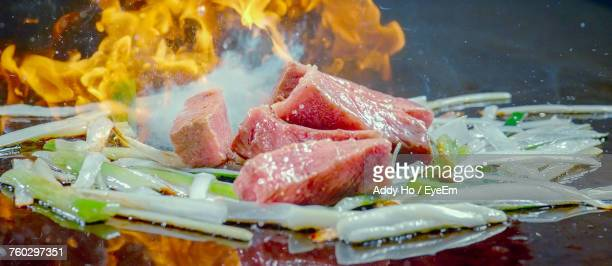 Close-Up Of Stir Fried Beef With Flame