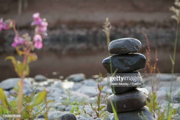 close-up of stone stack on rock - carlisle stock pictures, royalty-free photos & images