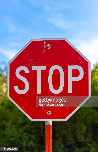 close-up of stop sign against blue sky - florin seitan stock pictures, royalty-free photos & images