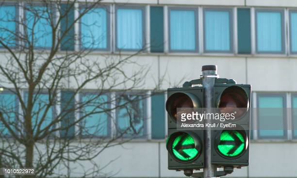 Close-Up Of Stoplight Against Building