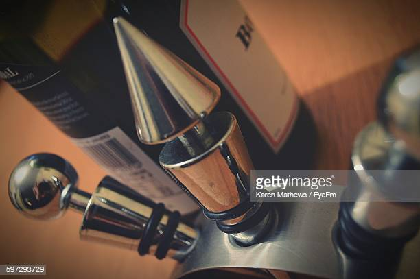 close-up of stoppers with wine bottle on table - bottle stopper stock photos and pictures
