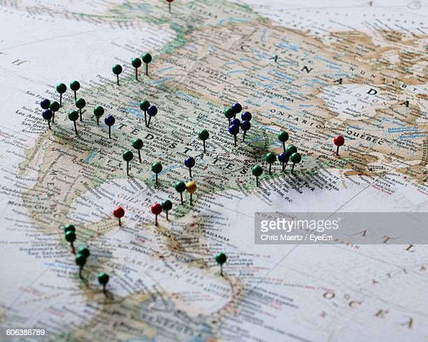 close-up of straight pins on map - cartography - fotografias e filmes do acervo