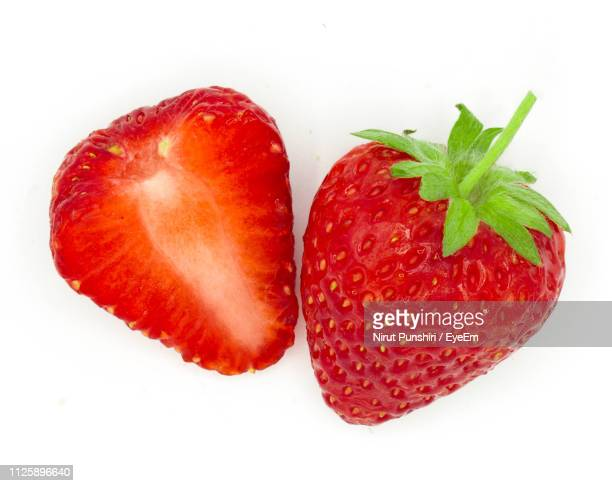 close-up of strawberries against white background - strawberry stock pictures, royalty-free photos & images