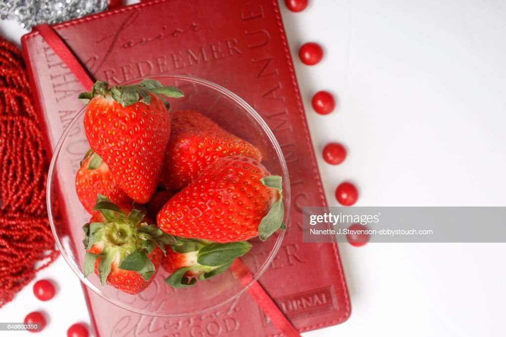 Closeup of strawberries on a journal : Stock Photo