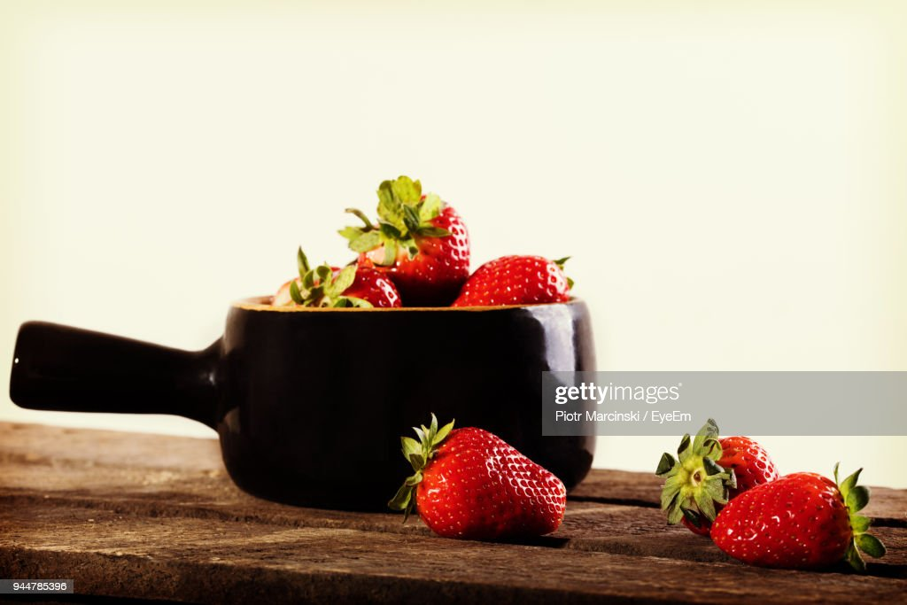 Close-Up Of Strawberries On Table Against White Background : Stock Photo