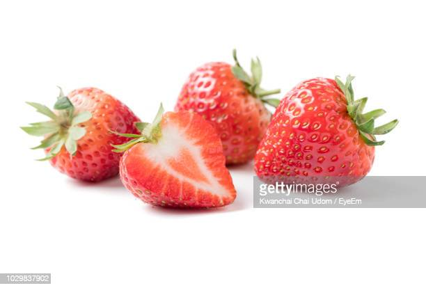 close-up of strawberries on white background - strawberry stock pictures, royalty-free photos & images