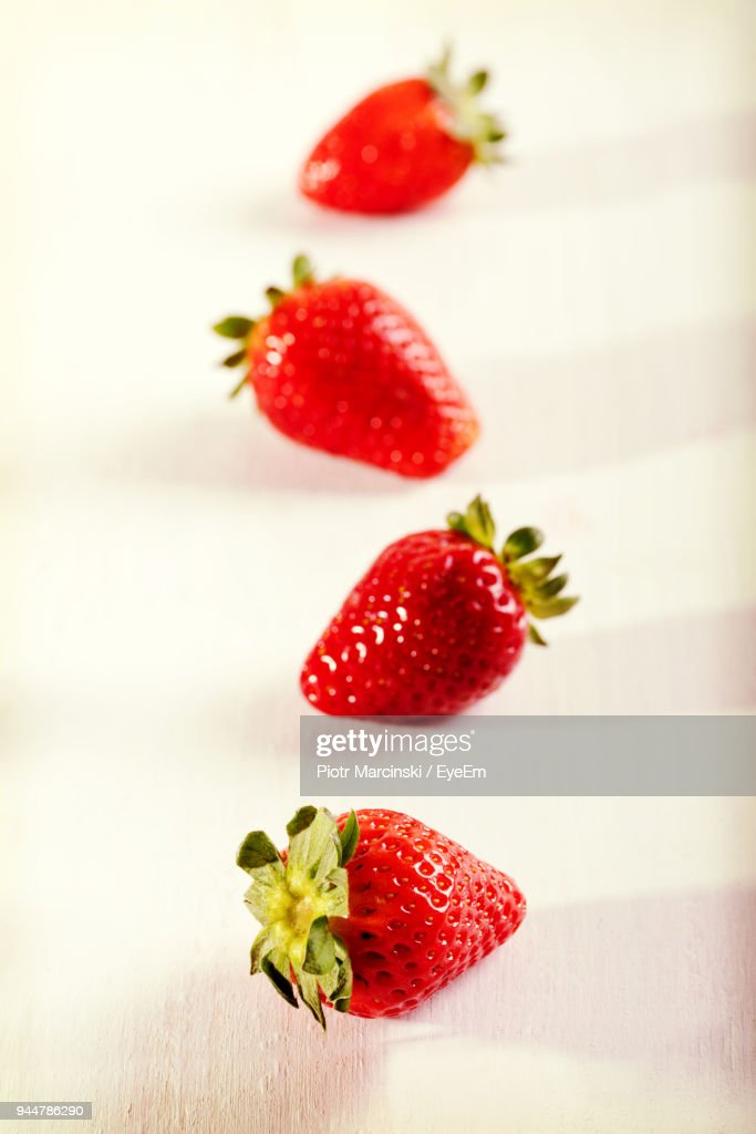 Close-Up Of Strawberries On White Table : Stock Photo