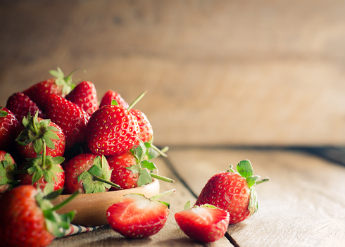 Close-Up Of Strawberries On Wooden Table - gettyimageskorea