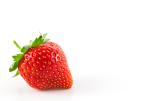 Close-Up Of Strawberry Against White Background - gettyimageskorea